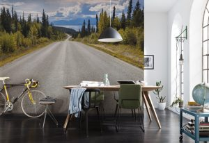 Ambiente decorado com painel fotográfico com foto de estrada